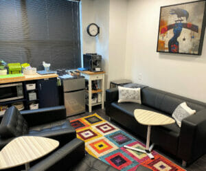 Academy Instructor lounge with coffee maker, microwave, refrigerator, and seating